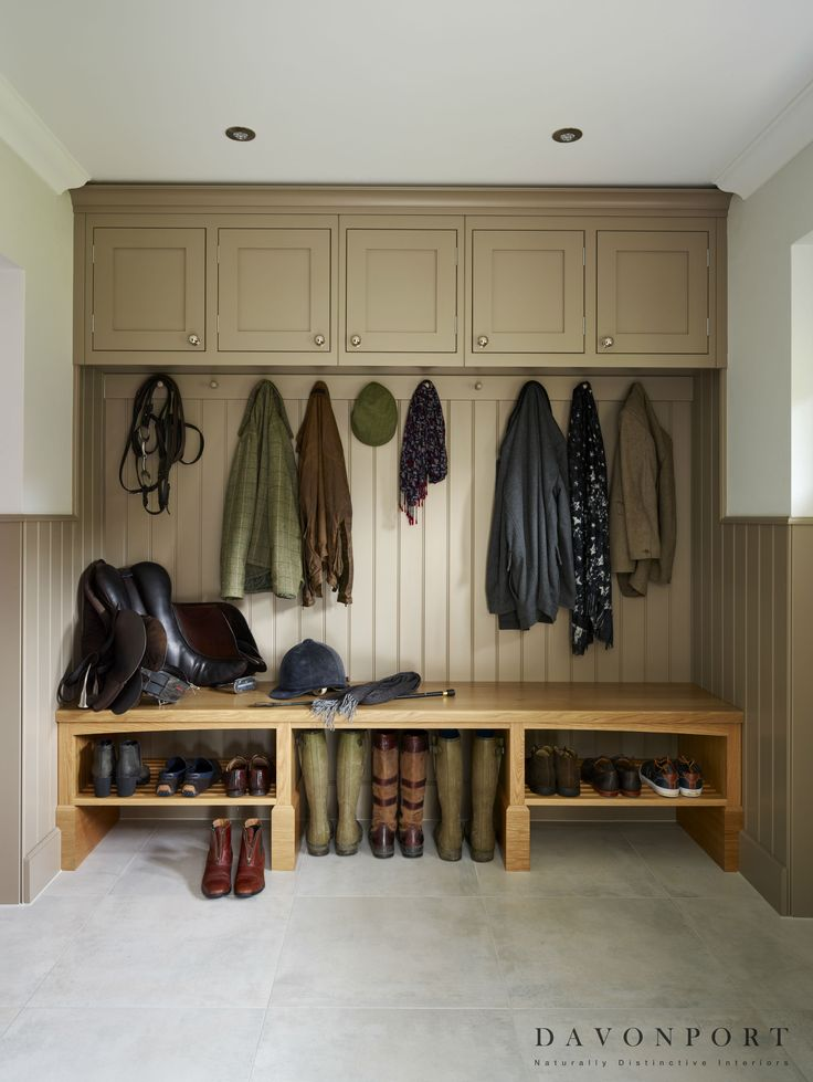 Bespoke cabinetry and wall panelling gives this boot room a beautiful country feel.