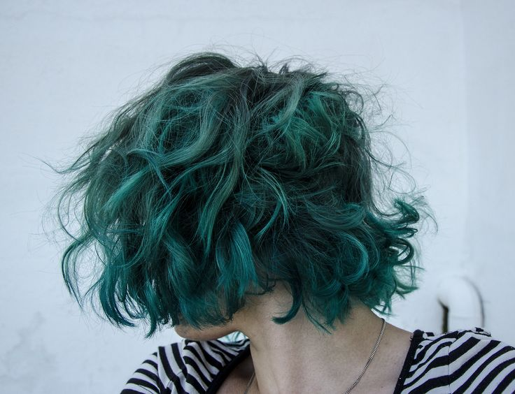 short tousled green turquoise bob hair - goes well with thin black and white stripes