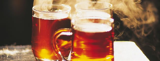 Ingredients: 1 cup red wine  1 cup of tea  1 cup spiced rum  1 cup plum brandy, Schnapps or any other liqueur to hand  1 cup orange juice  2 to 3 whole cloves  1/4 of cinnamon stick sugar  2 lemon slices
