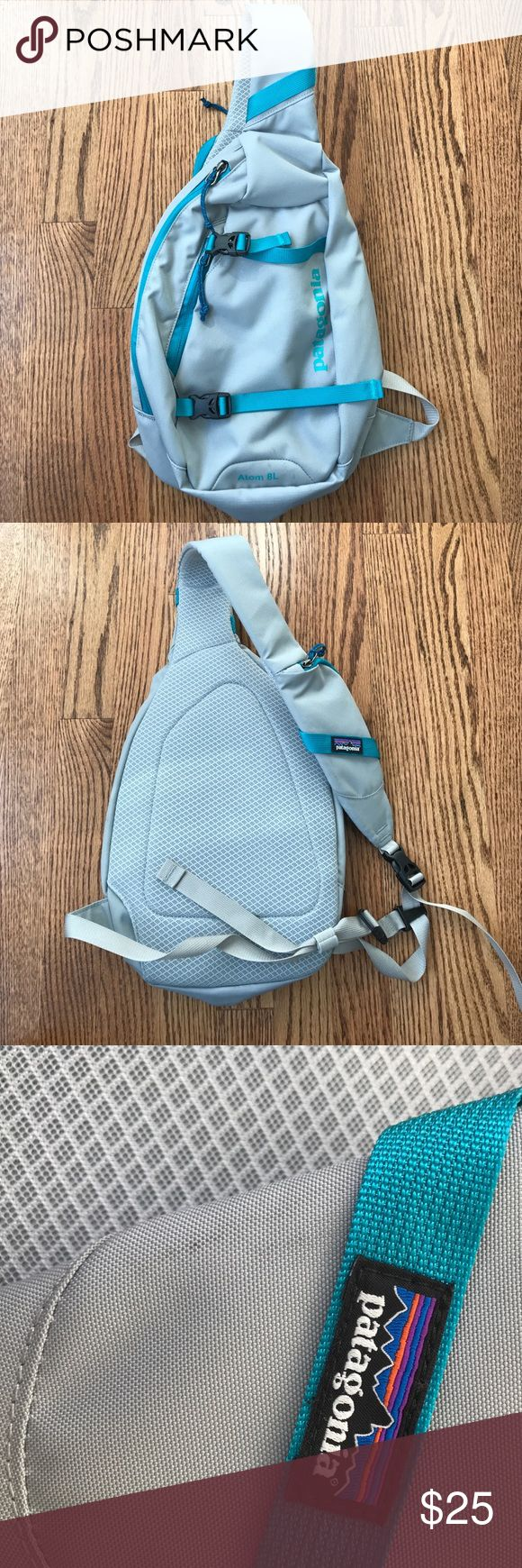 Patagonia cross body bag- grey and teal Gently used Patagonia cross body backpack in grey/real with adjustable straps, cell phone pocket, and interior compartments. Used for 1 trip, only a few light marks (see last 2 photos) which should come out relatively easily. Patagonia Bags Backpacks