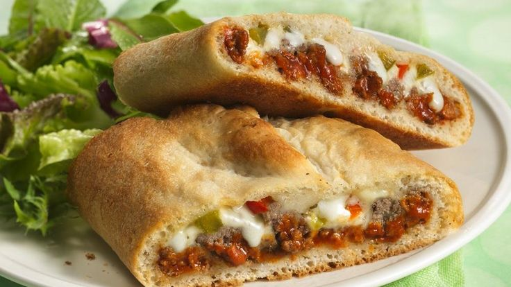 Stromboli is a family dinner favorite. Make it easy when you roll up pizza toppings in a pizza crust.