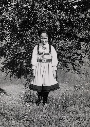 Portrait of a girl in a Setesdal-costume. Photographs from Setesdal around 1940-42