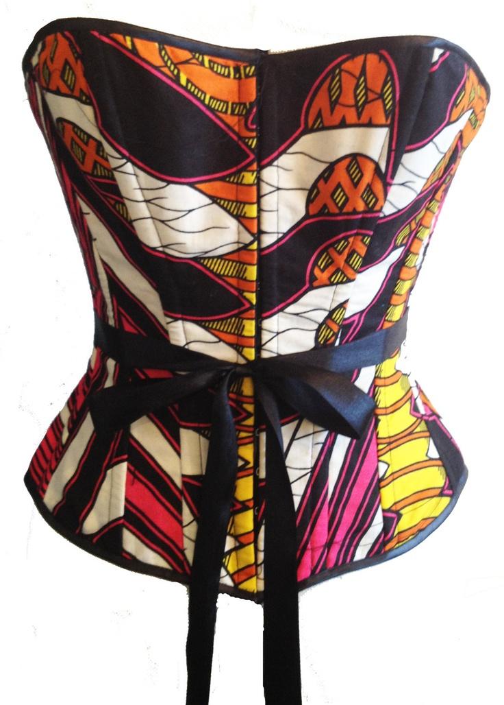 AZTEC QUEEN: 12 Panel black, orange, pink, yellow & white print corset top. £85.00, via Etsy.