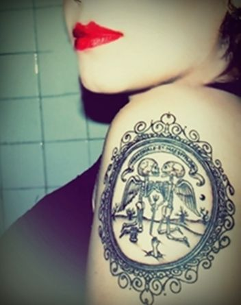 #tattoo love the the idea of having and antique frame like this except w something else in the center!!