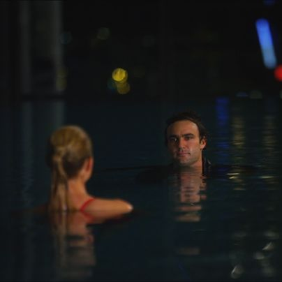 Nina imagines Patrick before her in the pool.  They share a kiss and he disappears.