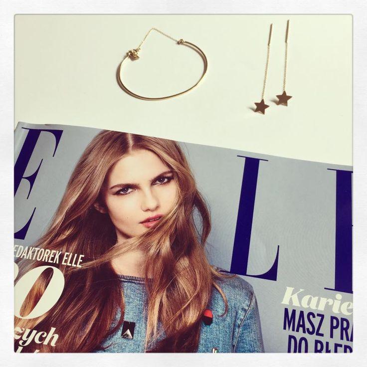 Minimal gold bracelet and earrings.