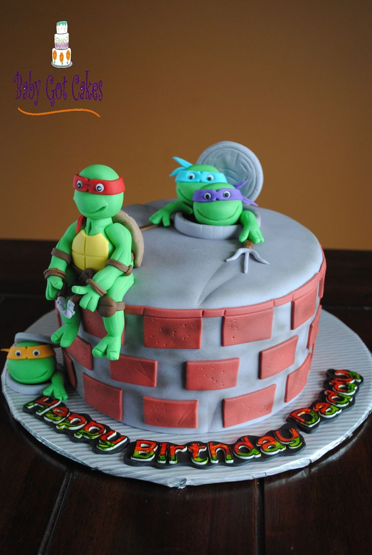"""Teenage Mutant Ninja Turtles - A little boy wanted a ninja turtle themed cake for his dad!!!  This is an 8"""" round covered in fondant with some airbrushing.  The turtles are handmade from fondant.  The design is inspired by many, wonderful online cakes.  Thanks for looking!"""