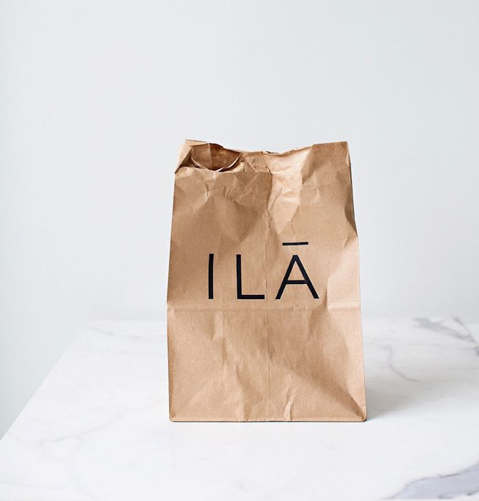 ILĀ concept of simple logo on brown paper bags, repetition of simple object such as this as a vignette
