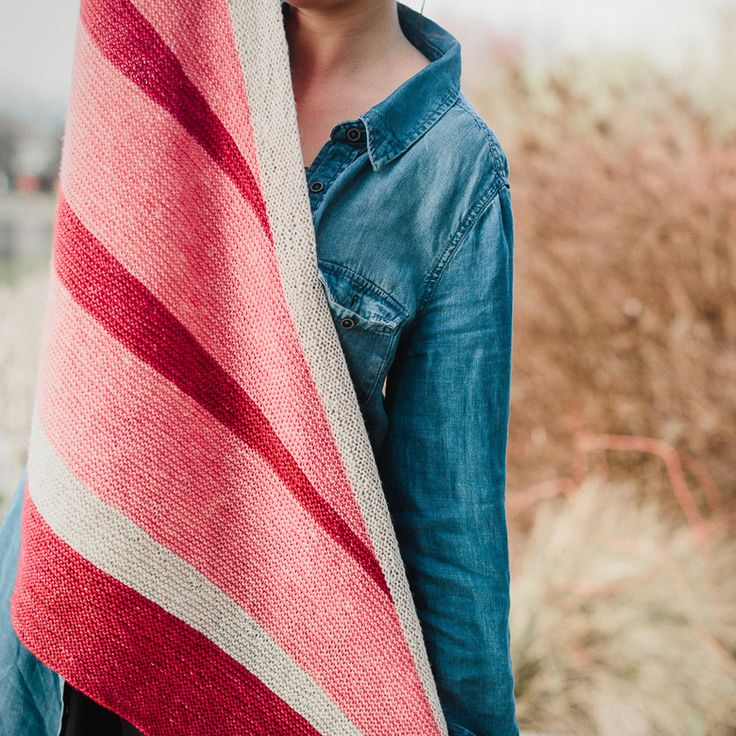 With a simple, modern construction, this gently asymmetrical shawl evokes the…