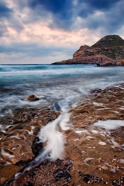 ღღ Spain - Cabo de Gata: Rugged Foam streams back into the ocean off the rugged coastline of Gabo de Gata Natural Park, a UNESCO world heritage site in Spain.