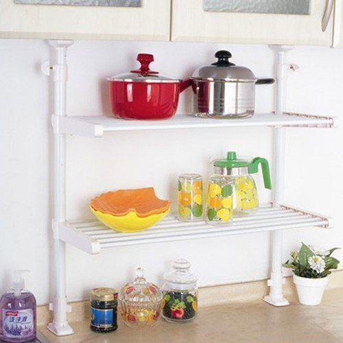 Capable Household Kitchen 2 Tier Hanging Storage Rack / Shelving Unit / Organizer TCR-00011, White by Capable. $32.99. This is for the organizer only. Shelf and contents are not included.. Material: Metal tube and Plastic; No rusting, chipping or cracking. Dimensions (L x W x H in inch): 26.5 x 10.2 x (26~39.4). Easy to assemble. Each of the two shelves has a 11 lbs. weight capacity.. The multi-purpose unit lends convenience and style to any room in the home and bathroom. Us...