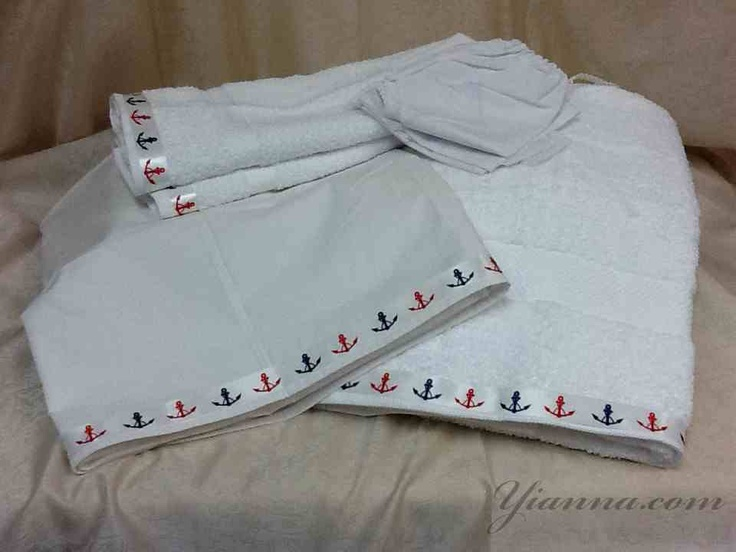 "Nautical set LDNAUT This Set without Personalization is $98.00. Our Lathopana sets are 100% cotton fabrics decorated with delicate laces and appliqué crosses and they are seven pieces in a set : the Holy oil sheet (46""x 58"") three pieces of undergarments (panties ,shirt, hat) one extra large white towel (30"" x52"")and two white hand towels (16""x30"") .The Holy oil sheet and the towels have the exact matching ribbons ,laces and crosses."