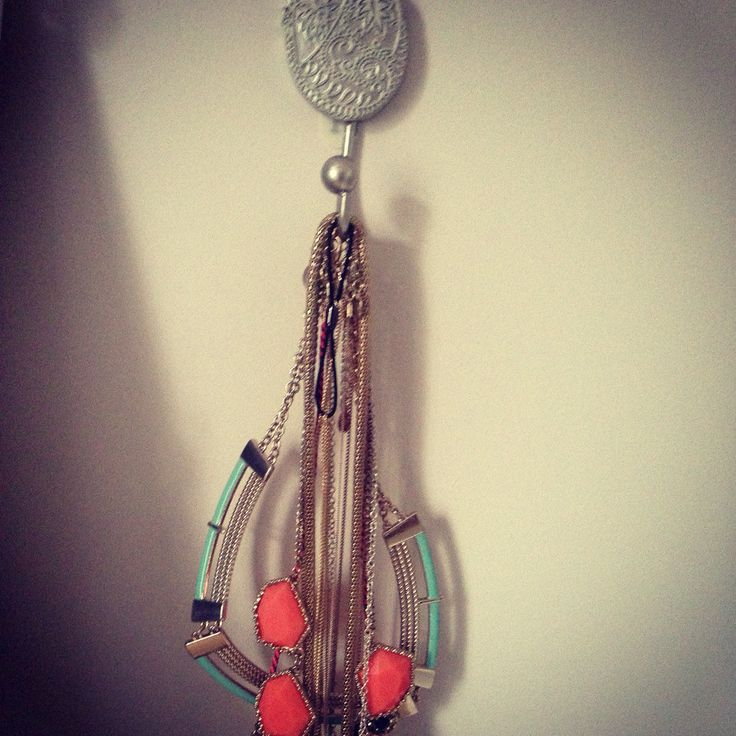 Got fed up of always having to untangle my jewellery so I bought an old bathroom door hook and stuck it up!  My very own necklace hanger!