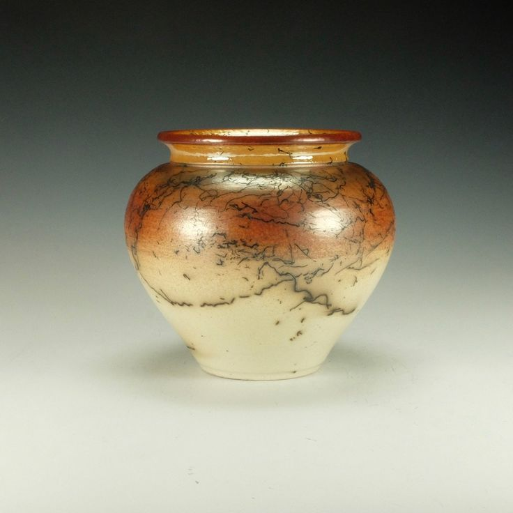 Horsehair Raku Vessel No. 1 by Lance Timco. Wheel-thrown stoneware pottery. Covered in several layers of terra sigillata and hand polished. Clear crackle glazed interior and lip. Raku fired with horsehair and iron. The soft sheen comes from the terra sigillata. Signed on the bottom by the artist. The image is representative of the piece for sale. For decorative use only. The clay remains porous and is not suitable for holding water.
