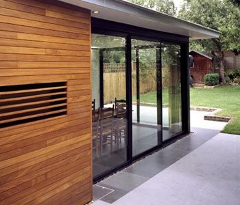 rear extension with natural wood cladding and overhang roof with small lights - excellent!