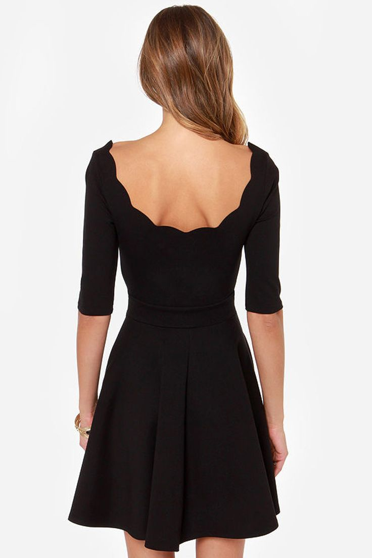 Such a darling black dress. Love the scalloped detail.