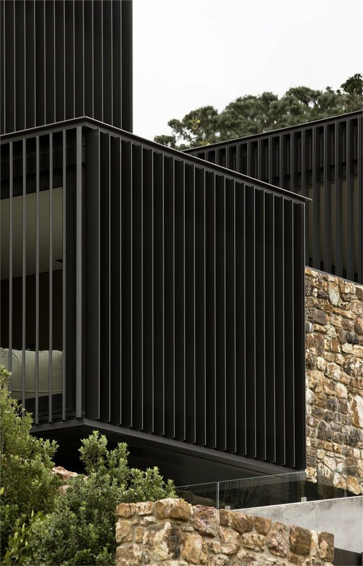 Love the juxtaposition of the black boxes and the rock walls.  Local Rock House, Waiheke Island, 2012