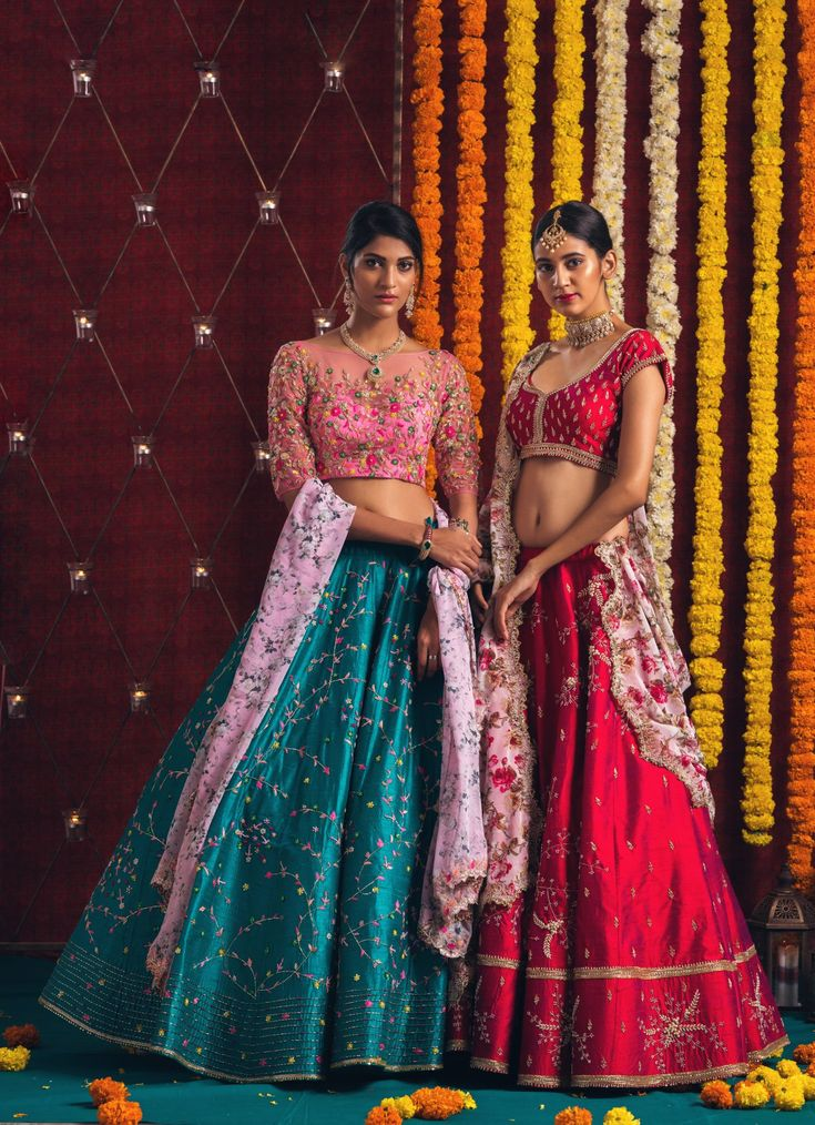 The more you celebrate your life the more there is in your life to celebrate.Izza contemporary colour pop lehenga in pink and green with a custom-made floral cut work dupatta and passion red lehenga with floral cutwork dupatta to keep those looks hooked.<br> Jewellery Courtesy: Sitara Jewellery. <br>They can customize the dress as per your requirement. For more details  WhatsApp on 9949944178 or mail at info@issastudio.com. 27 February 2018