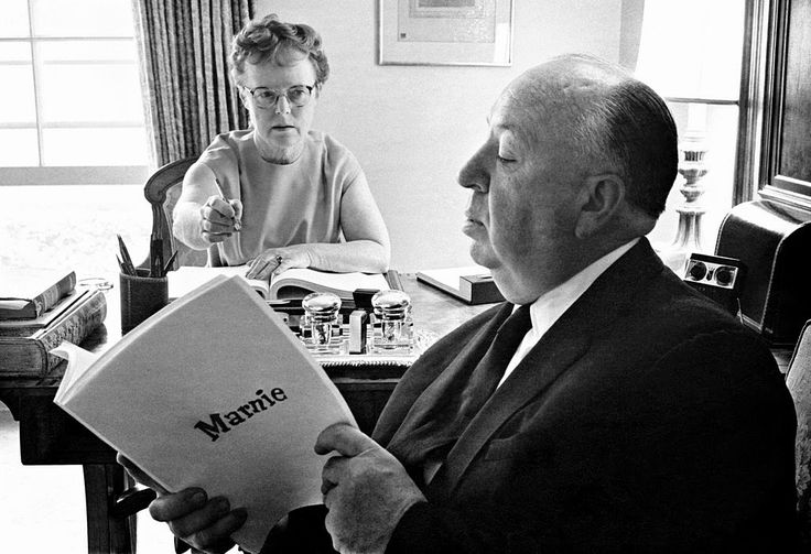 Alfred Hitchcock and his wife Alma Reville discuss the script for Marnie, 1964