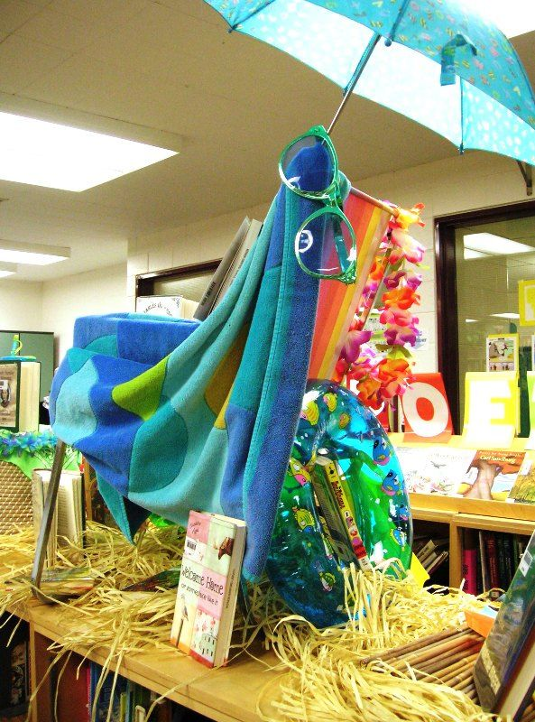 https://flic.kr/p/877YiR | Start Your Summer Reading Early | Part of our summer reading display. Who knew an old 1970's lawn chair, a beach towel, a child's umbrella and a bunch of pool toys and other summer stuff could make a great display so quickly?!