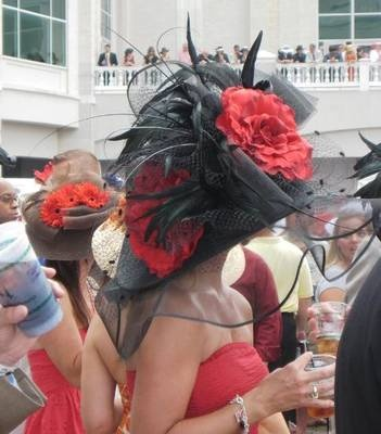 Photo © Steve Ryan: If you're going to the Kentucky Derby, you'll want to make sure you're familiar with Kentucky Derby fashion. Men at the Kentucky Derby generally wear suits--any color goes at the Derby. Women pair simple dresses in spring colors with their Derby hats.