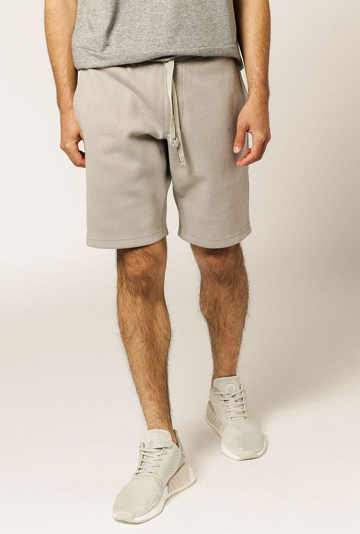 Modern fabric design meets classic sportswear in this lightweight athletic short. Handcrafted in Canada from custom mesh-backed linen, with in-seam pockets and a premium elastic waist.  Features a custom mesh-backed linen, flatlock stitching, signature fading 3-stripes, in-seam pockets, premium rib waist, emroidered crest, herringbone tape drawcord, and rib gusset.  - Main: 83% Cotton, 17% Linen   100% Polyester - Pre-washed; Wash cold, hang dry - Made in Canada...