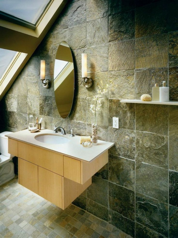 Bathroom With Oval Mirror And Natural Stone Tiles Using Natural Stone Bathroom Tiles Check more at http://www.wearefound.com/using-natural-stone-bathroom-tiles/