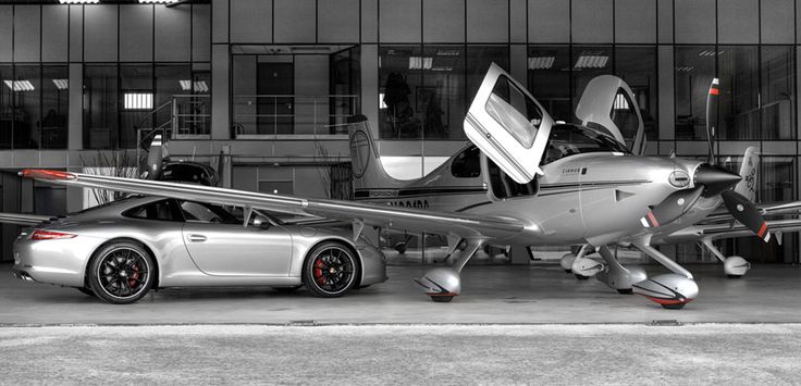 This is all i want in life. A hangar with a Cirrus SR22 GTS and a smokin hot car <3