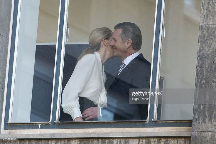 Former German First Lady Bettina Wulff and her estranged husband, former German President Christian Wulff, welcome each other at the Landgericht Hannover courthouse on December 12, 2013 in Hanover, Germany. Wulff is accused of allowing film producer David Groenewold to pay for a Munich hotel booking while he was governor of Lower Saxony in exchange for Wulff's support in promoting one of Groenewold's films. Wulff is the first post-World War II German president to face a court trial.
