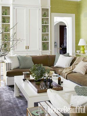 green walls, white accents, brown sofa (love the shelving and cabinets behind the sectional-L)