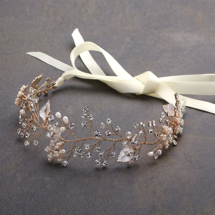 """Intricate hand-painted silver leaves with freshwater pearls and fiery crystals give Mariell's gold ribbon vine headband couture style. With 10"""" of breathtaking hand-wired sprays and 16"""" double ribbons"""