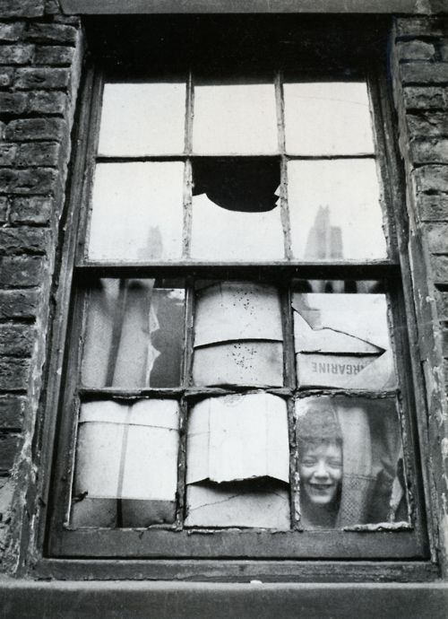 In the slums, Liverpool, U.K 1955. Photo by Thurston Hopkins. (me--I like how he's happy)