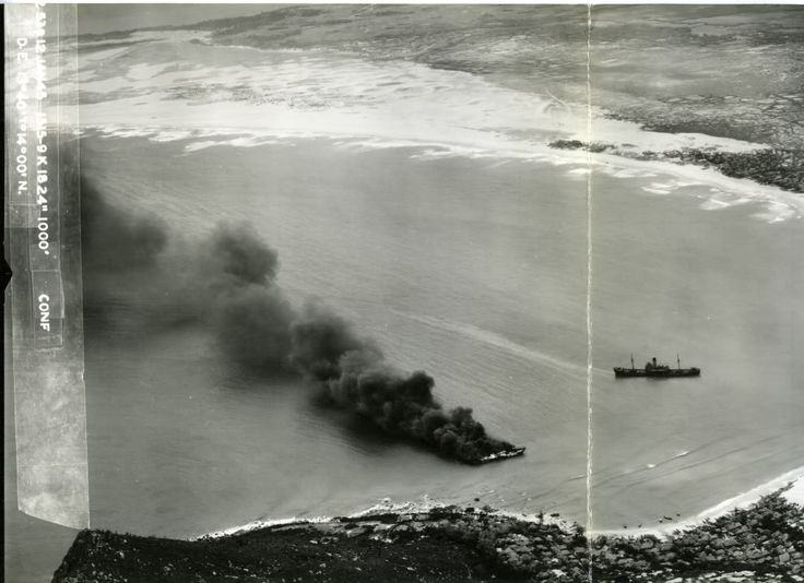 One Japanese freighter beached and burning and another grounded by the stern and trailing oil on the coast of French Indochina (Vietnam) north of Qui Nhon after being attacked by 175 USN carrier planes, Jan 12, 1945.