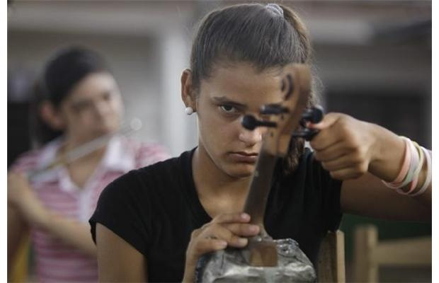 Children discover Mozart in Paraguay landfill, playing instruments made from recycled garbage