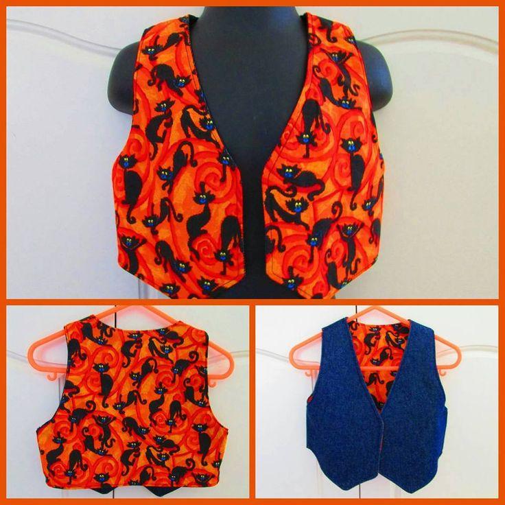 Handmade by TK's Bowtique  Description: Black Cat Reversible Vest. For more information, please visit https://www.facebook.com/HandmadeMarkets