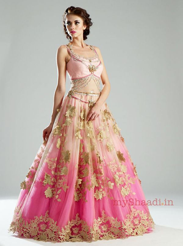A lovely ombre pink flared gown with 3D crochet flower embellishments.