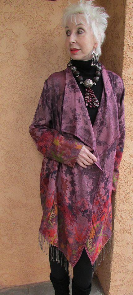 Gretchen Shields, jewelry designer wearing her own necklace and purple Mist topper wool blend garment.