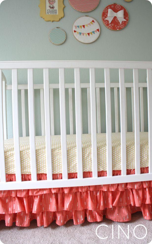 DIY ruffle crib skirt. I also like the wall hangings. Love the bow