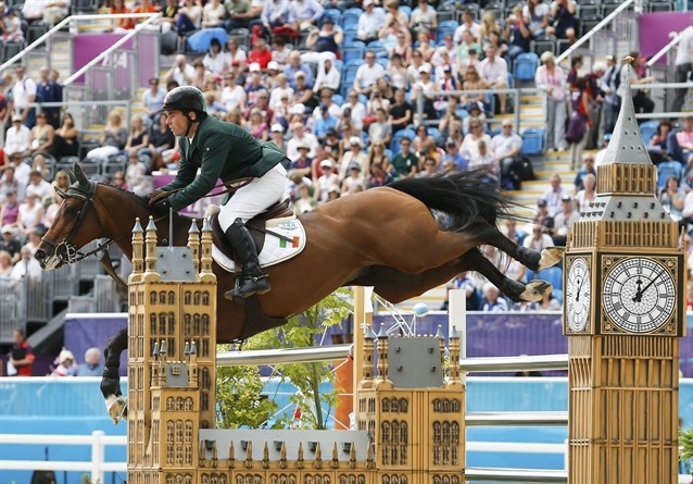 Individual Jumping Finals - Equestrian Slideshows | Cian O'Connor of Ireland riding Blue Loyd 12 performs during the equestrian individual jumping final at the London 2012 Olympic Games in Greenwich Park August 8.  (Photo: JORGE SILVA / Reuters) #NBCOlympics