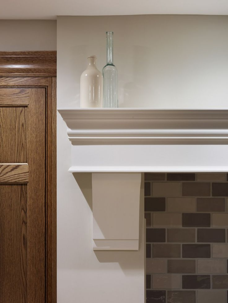 """The #Nickleby kitchen design installed in St. Albans has handpainted cabinetry in Farrow & Ball """"Slipper Satin"""" - here you can see the over mantel with the smoked oak folding wooden cupboard doors flank each side of the range. #humphreymunson #farrowandball #slippersatin #lacanche #oak #kitchen #interior #design"""
