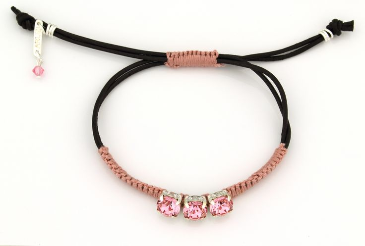 The soft pink Swarovski crystals provide just enough sparkle to this cute bracelet. www.arlizi.com