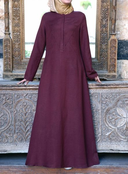 Evoke the spirit of Summer with this easy-to-wear Abaya. Its pure structured elegance is epitomized by subtle geometric topstitched panels along the upper front of the dress. The breezy linen will keep you looking and feeling comfortable in the warm-weather months. Note: This product requires 3 working days processing time before it is shipped.
