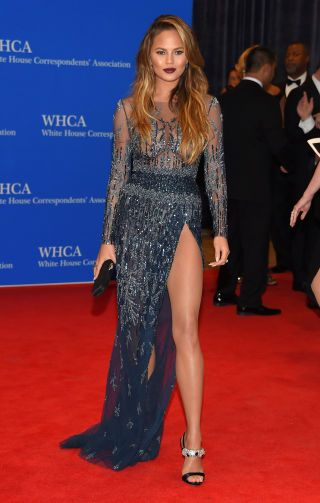 Chrissy Teigen attends the White House Correspondents Dinner. All the best red carpet looks here: