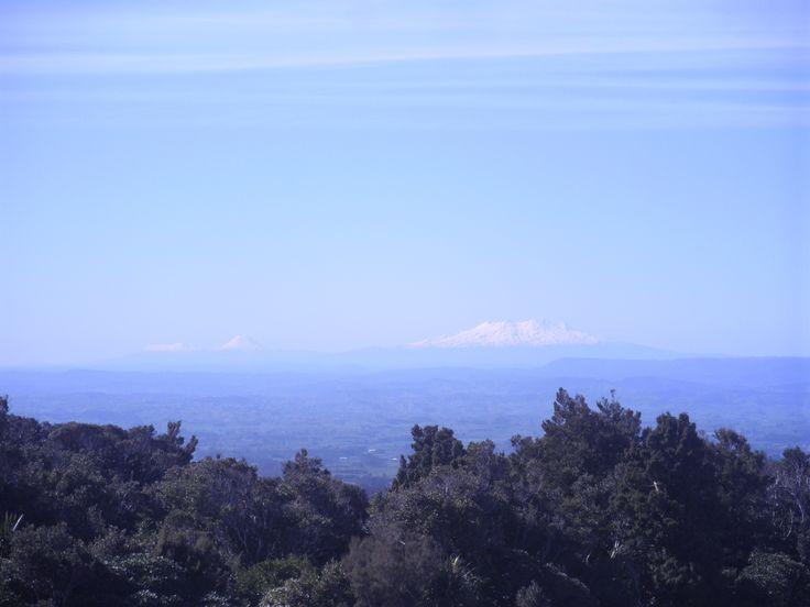Mount Ruapehu (2,797 metres), Mount Ngāuruhoe (2,287 metres) and Mount Tongariro (1,978 metres), as seen from the Dawson Falls lookout tower on Mount Egmont.