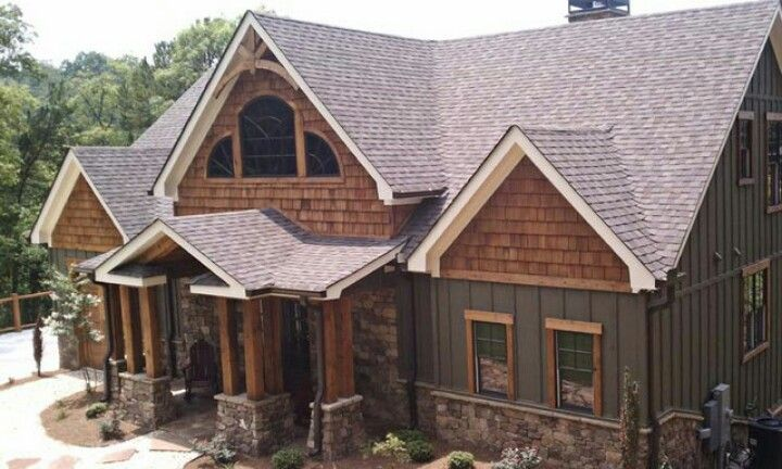 Amazing craftsman home with board and batten siding, cedar shake shingles and window trim.