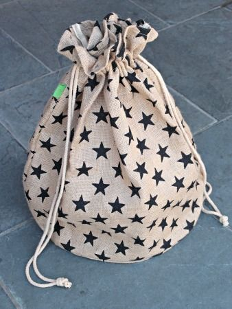 Christmas Sacks - Star print. A gorgeous large drawstring jute bag, perfect for Christmas presents and storage for the rest of the year. We love this bag!