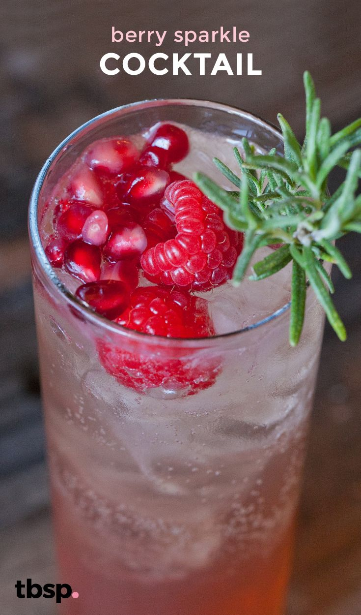 A festive cocktail that's sweetened with honey and a splash of pomegranate liquor and garnished with fresh holiday berries.