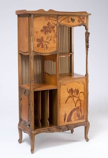 Etagère, c. 1900 Louis Majorelle  Louis Majorelle's furniture received international acclaim at the 1900 Paris Exposition Universelle at which he showed furniture with landscape and flower designs described in marquetry (inlaid wood) or carved into polished, luxurious woods.