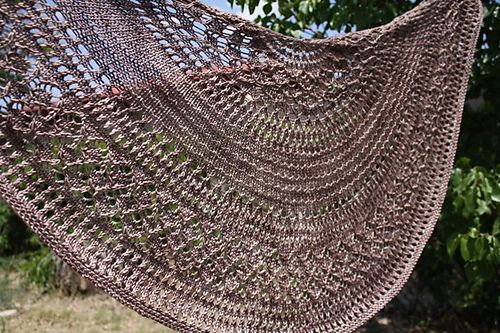 This shawl was inspired by the architecture of the Eiffel Tower. It's been years since I lived in France but the structure made an impression on me. You can see the criss-cross lattice lace bordered by rows of eyelets and separated with a panel of ridges meant to suggest the platform sections of the tower.