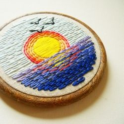 An embroidery design inspired by vintage beach tees.